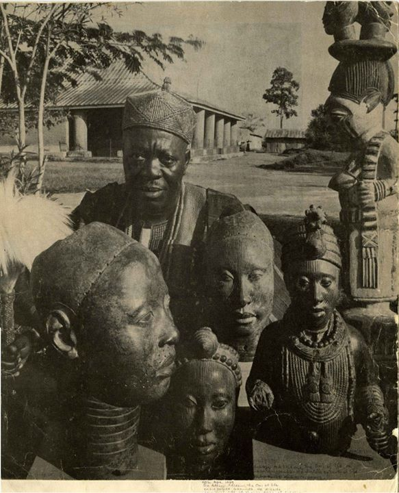 The Ooni of Ife, His Royal Highness, Oba (Sir) Adesoji Tadeniawo Ayinla Aderemi, the Ooni of Ife. 1930 – 1980 ,with some of the bronze ife heads.